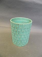 A Chinese green brush pot moulded in the form of