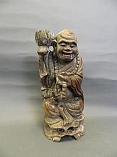 A large C19th Japanese carved wood figure of an