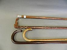 A Hallmarked silver topped walking stick, and 3