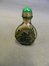 A Peking glass snuff bottle with raised overlaid