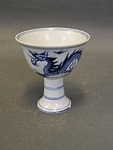 A Chinese blue and white stem cup with painted