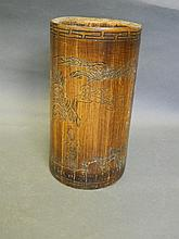 A Chinese bamboo brush pot with carved decoration