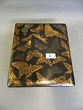 A C19th Japanese lacquered box decorated with