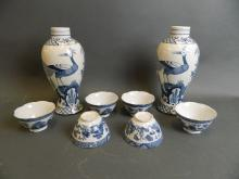A pair of English blue and white porcelain jars decorated with Asiatic pheasants, together with six blue and white tea bowls with petal shaped rims and temple decoration, jars 9