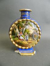 A Continental porcelain blue ground flask with painted decoration of figures and animals in farmyard scenes and gilt highlights, 6