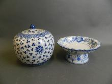 An Oriental blue and white porcelain tazza with frilled rim and floral decoration, together with a blue and white porcelain ginger jar with scrolling lotus decoration, largest 6½