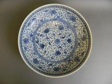 A Chinese blue and white porcelain charger with scrolling lotus flowers decoration, seal mark to base, 12