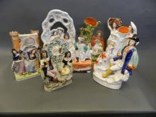 Eight C19th Staffordshire flat back figures including watch holders, largest 14