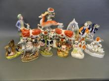 A collection of C19th Staffordshire figures including cattle, zebra etc, largest 11½