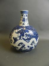 A Chinese blue and white porcelain moon flask with incised dragon decoration, 4 character mark to base, 12½