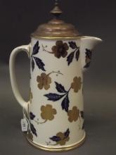 A C19th porcelain jug with silver plated and gilt cover, stamped with the Royal Warrant, jug marked 'Thos. Goode', 12