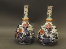 A pair of Oriental mallet shaped porcelain vases with bright enamel decoration depicting chrysanthemums on a bamboo trellis, 6 character mark to base, 11