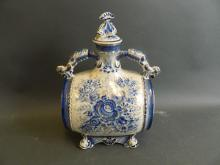 A Russian porcelain barrel shaped wine/spirit decanter, raised on four dolphin mask feet, 12