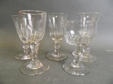 Five C19th panel moulded stem wine glasses, tallest 4