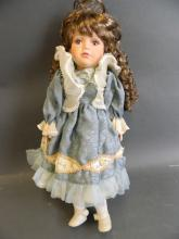 A 'Curzan Collection' porcelain doll, boxed, 16