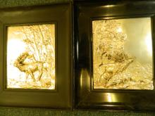 A pair of framed embossed and applied silver plated plaques of stags in landscapes, 8