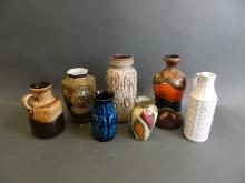 A collection of seven Continental pottery vases with assorted glazes and firings, various marks to bases, mostly West German, largest 9