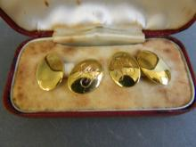 A pair of Hallmarked 15ct gold cufflinks with monogram decoration, 7.4g