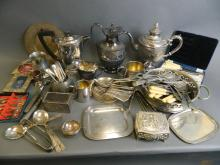 A quantity of silver plate to include three teapots, cutlery, coasters etc