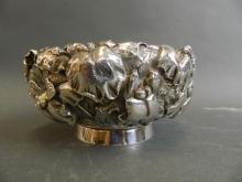 A Japanese silver bowl, the body embossed with flowers and leaves in the iris pattern, on a pedestal base, 6