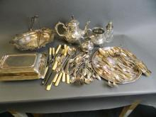A quantity of good quality silver plate including a three piece tea service, swing handled cake basket, entrée dish etc, and a large quantity of flatware