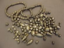 An Indian silver metal/low grade silver necklace, and a collection of beads