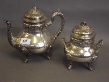A C19th French Hallmarked silver teapot, 680g, and a matched bowl and cover with indistinct maker's mark, 429g