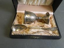 A Continental silver egg cup and spoon in a presentation box