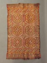 An antique red ground Kilim carpet, 20