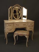 A painted five drawer kneehole dressing table with Neo-Classical style parcel gilt decoration, with matching stool and triptych mirror, 42