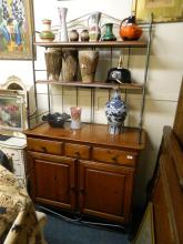 A contemporary Ducal pine dresser with shelved wrought metal upper section over two drawers and cupboards, raised on swept supports, 42