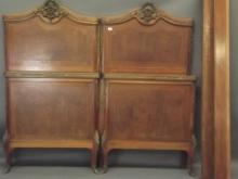 A pair of late C19th Italian inlaid mahogany bed ends with brass mounts, one with side rails, 36