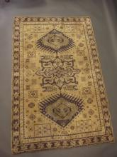 A wool carpet with deep blue Oriental patination on an ivory ground, 47