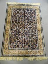 A Kashmiri blue ground carpet with all over floral design within an ivory border, 46