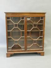 A C19th mahogany astragal glazed two door bookcase, raised on bracket supports, 38