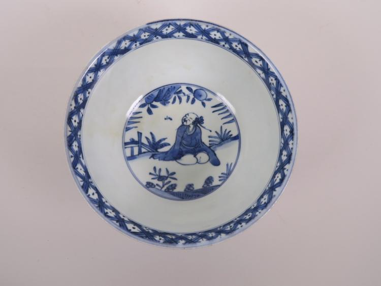 A Chinese Blue And White Porcelain Bowl Decorated With Figu