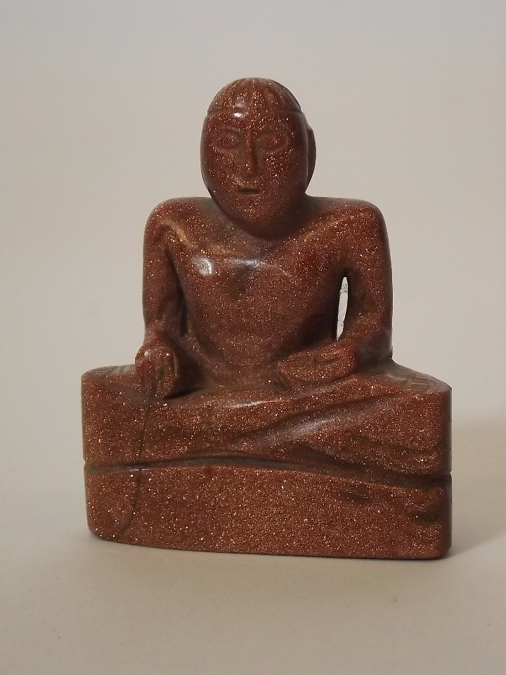 A chinese carved gold stone figure of seated monk ½ quot hig
