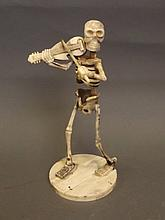 A bone figure of a skeleton playing a fiddle, 7½''