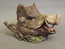 A cold painted bronze inkwell in the form of a