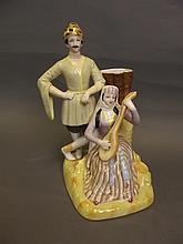 A Russian style ceramic spill vase group of a