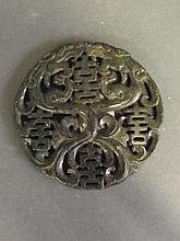 A Chinese green hardstone pendant with carved and