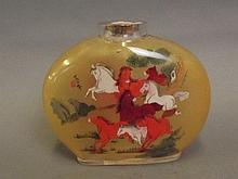 A large glass Chinese snuff bottle decorated with