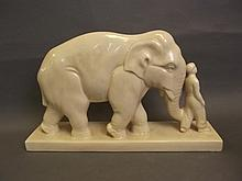 A large cream ground ceramic elephant and mahout,