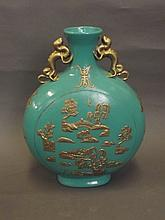 A Chinese twin handled green ground pottery moon