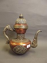 An antique large Tibetan brass and silver coloured
