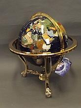 A terrestrial globe with inlaid semi-precious