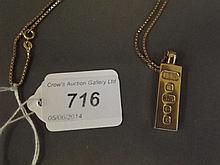 A Hallmarked 9ct gold ingot on a 9ct chain, 22g