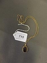 A Hallmarked 9ct gold pendant and chain set with a