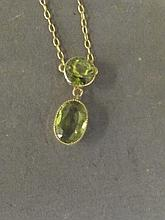 A 15ct gold double peridot pendant