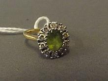 A Hallmarked 18ct gold diamond and peridot cluster